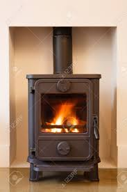 cast iron wood burning stove in a modern contemporary fireplace