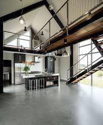 the double height space is punctuated by the catwalk which houses