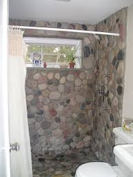 river rock bathroom ideas river rock applied into shower floor also wall and