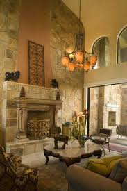 tuscan living room with arched window in and high ceiling