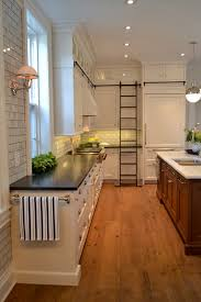 white kitchen cabinets with glass doors on top kitchen with row of cabinets with glass doors