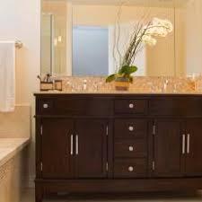 Photos HGTV - Dark wood bathroom cabinets