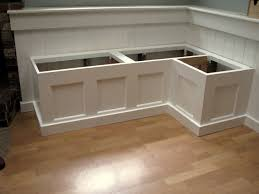 dining room booth built in the same cabinetry as the white kitchen
