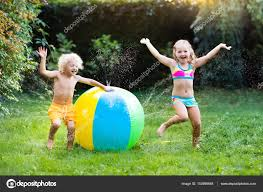 kids playing with water ball toy sprinkler u2014 stock photo