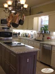 new vientian gold granite copper glaze over island pot rack