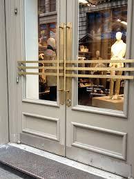 brass art deco handles on soho shop door in new york via lisa