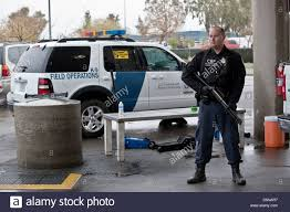a us customs and border protection officer watches the san luis