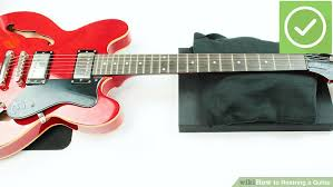 how to restring a guitar with pictures wikihow