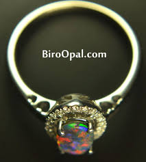 black opal 18 k black opal ring with diamonds biro opal