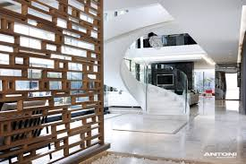 staircase design ideas at u shaped house design by saota and