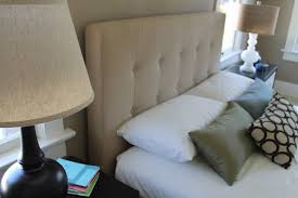 tufted upholstered headboard with his and her lamps traditional