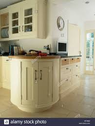 curved fitted unit in large traditional cream country kitchen