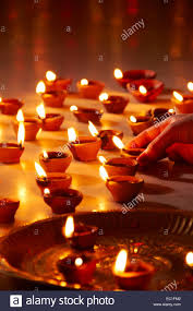 1 indian festival diwali home arranging diya worship stock