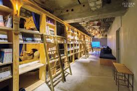 a tokyo hostel surrounds bunk beds with plywood shelves offering