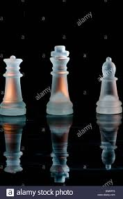 white frosted glass chess pieces king bishop rook reflecting