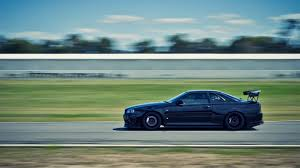 nissan r34 black download wallpaper 1920x1080 nissan auto black street full hd
