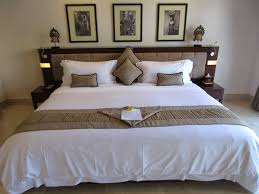 viceroy resort bali with elegant wooden master bed and headboard
