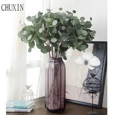 plante verte dans une chambre artificielle eucalyptus feuille plante verte table chambre d hôtel