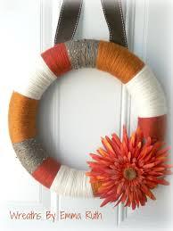 modern fall rustic yarn wreath with large flower via etsy