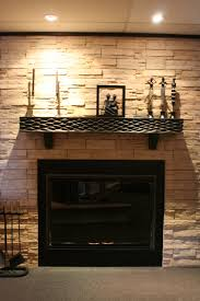 indoor fireplace ideas with modern tile texture wall between