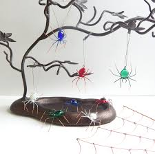 four small colorful spiders red green white blue home decoration