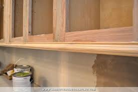 painting unfinished kitchen cabinets how to finish unfinished kitchen cabinets hitmonster
