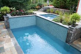 exterior swimming pool water rocks plants flowers stairs small