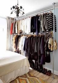 bedroom clothes bedroom with pipe clothes rack organizing with useful clothes