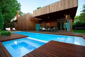 mahogany decking pool modern with blue interior ceramic tiles