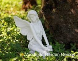 marble resin sitting garden ornament woodside garden
