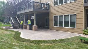 Stone Decks And Patios by Double Decks Under Deck System And New Stone Patio Des Moines