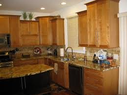 best granite for maple cabinets maple shaker door praline light maple cabinets with new venetian gold granite google search