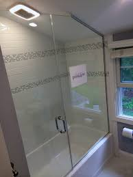 glass panel shower door a simple shower door installed above a tub and butting a panel