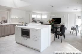 furniture white kitchen island with black chairs and banquette