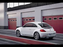 white volkswagen 2012 volkswagen beetle white rear and side 2 1920x1440 wallpaper
