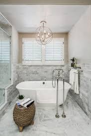 best ideas about bathroom chandelier pinterest master metal orb chandelier centered above the freestanding tub this master bathroom making
