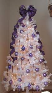 white tree with purple ornaments galore more