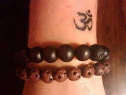 31 excellent om tattoos designs on wrist