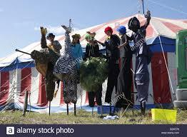 clown stilts for sale of in clown costumes walking on stilts blue