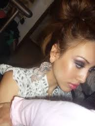 side view of pulled back hair in a bun big hair bigger lashes should i get bangs dark purple