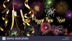 new years chagne flutes happy new year text chagne flutes and fireworks stock photo