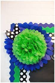 pom pom on top of paper daisy with multiple borders easy way