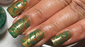 try this stunning green u0026 gold water marble nail design