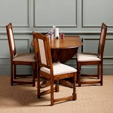 round dining room table with leaf and chairs dining room table