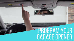 Syncing Garage Door Opener With Car by How To Program Garage Opener In Your Volkswagen Youtube