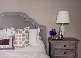 gray velvet headboard with purple pillows transitional bedroom