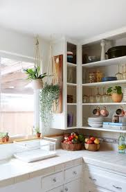 remove kitchen cabinet doors for open shelving this kitchen cabinet design hack is a renter s