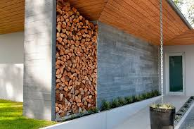 the artful woodpile 30 fabulous firewood storage ideas