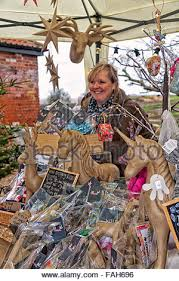 stallholder selling christmas decorations christmas market