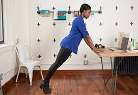 exercises to do at your desk desk exercises the best moves you can legit do at work greatist